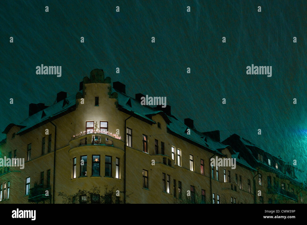 Raindrops on residential building - Stock Image