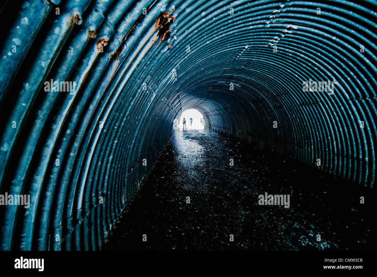 People ice skating in tunnel - Stock Image