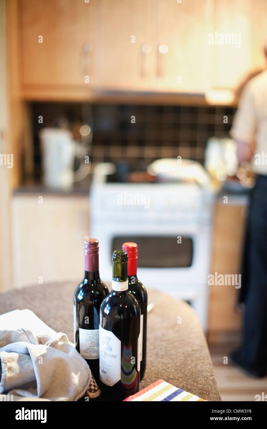 Wine bottles in kitchen - Stock Image