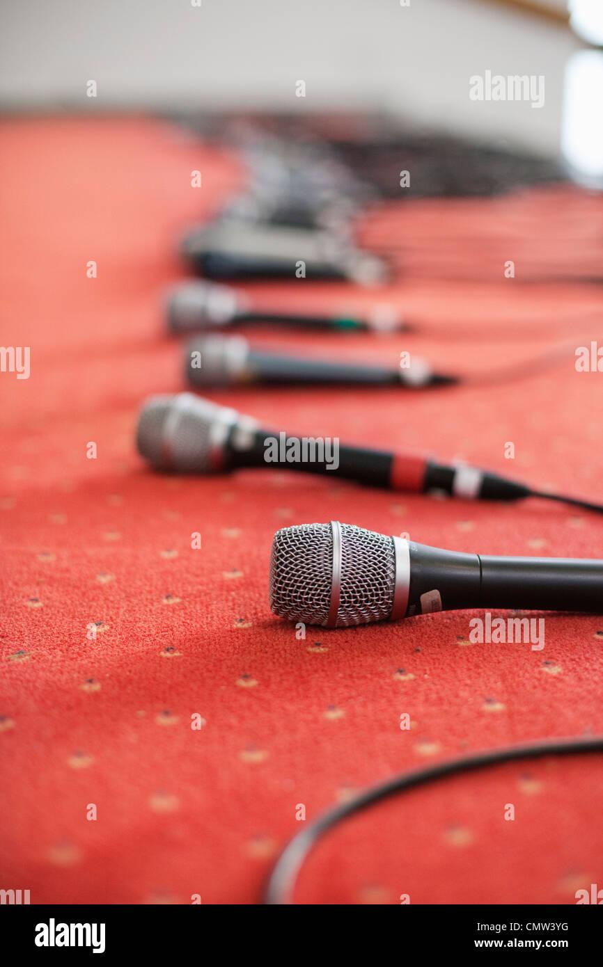 Microphones kept on rug - Stock Image