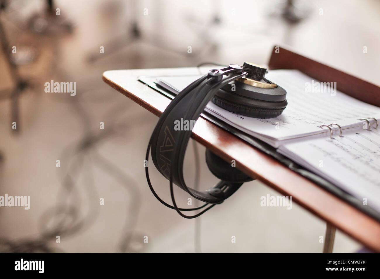 Headphones in music studio - Stock Image