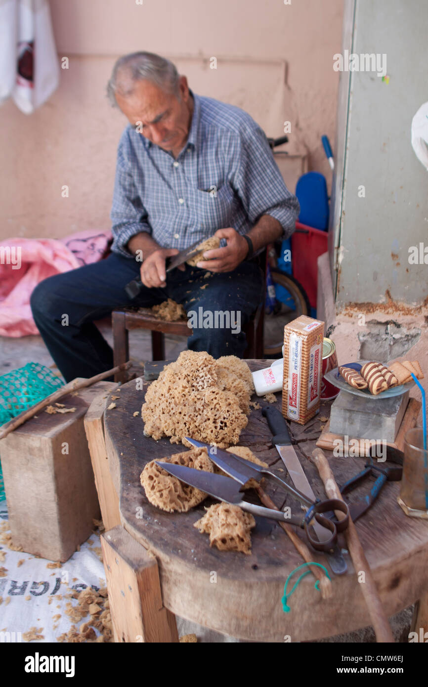 A Man trimming Greek Natural Sponge on the island of Kalymnos, Greece - Stock Image