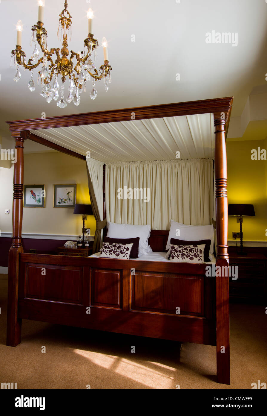 Four Poster Bed In Five Star Hotel Room With Chandelier