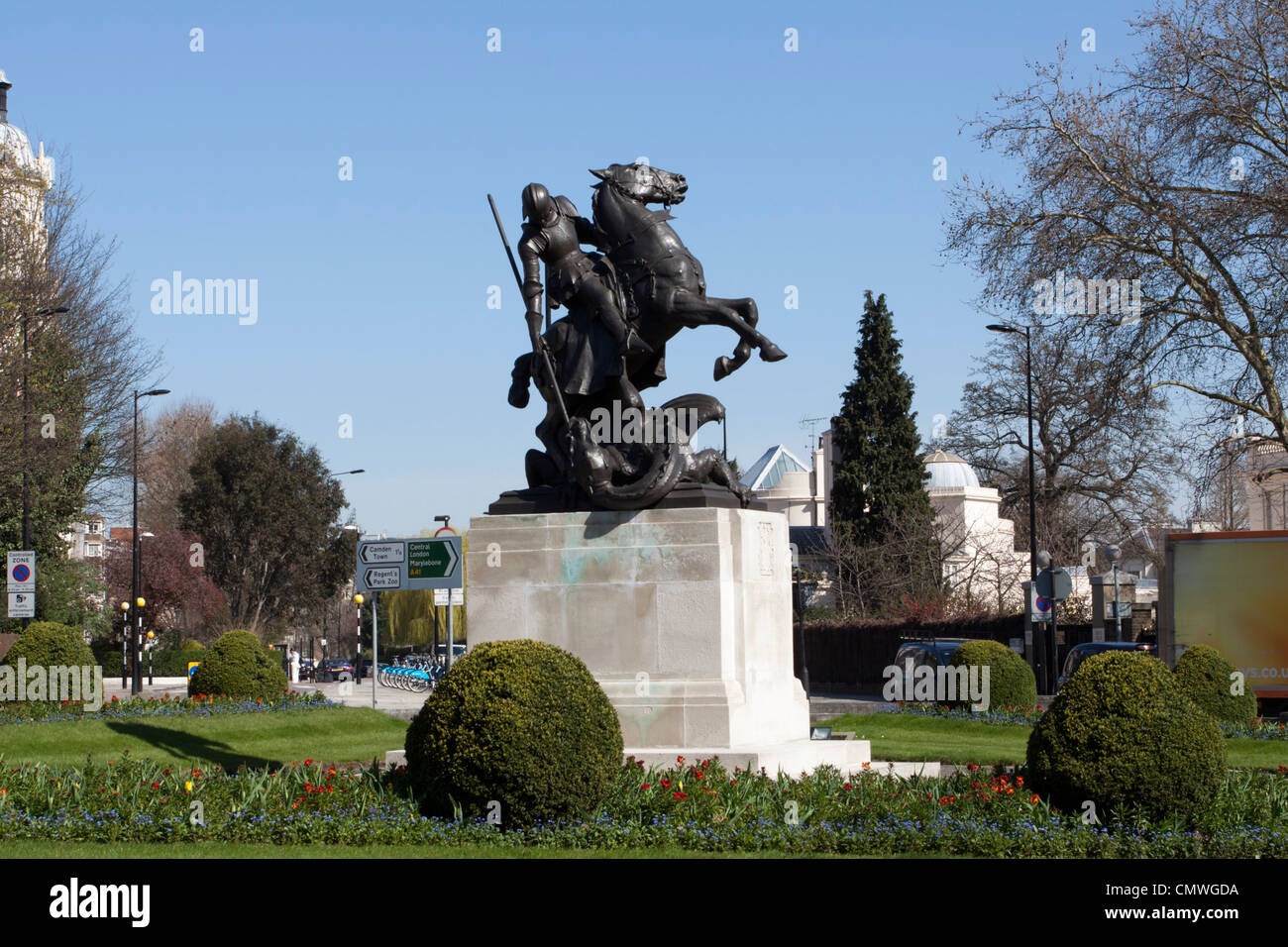 St George slaying the dragon, monument to those killed in both World Wars, St Johns Wood, London, England, UK - Stock Image