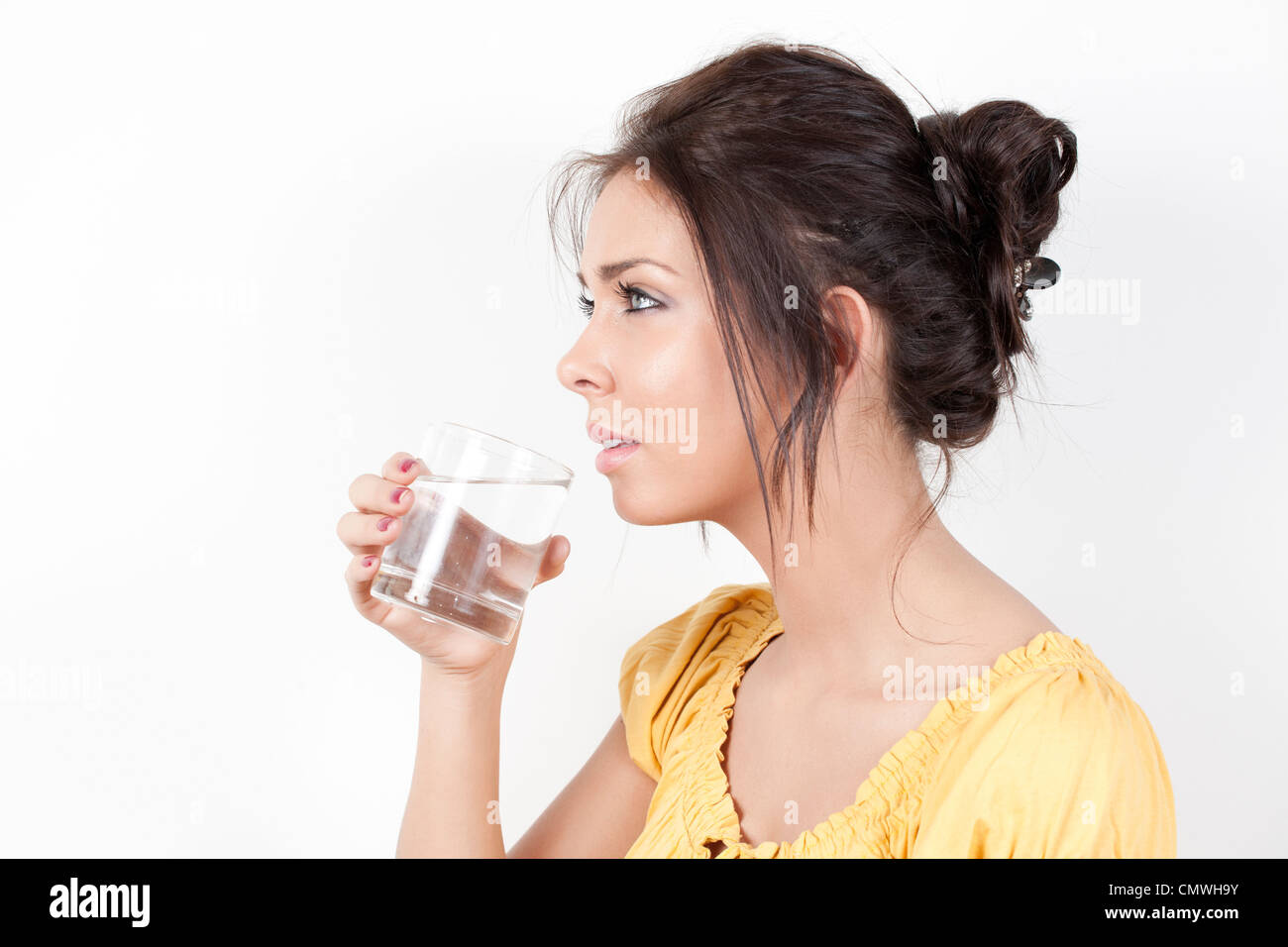 Woman drinking water - MR - Stock Image