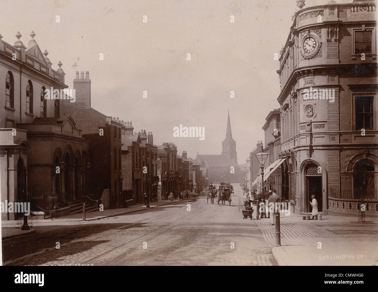 Darlington Street, Wolverhampton, 1890s. Darlington Street at the junctions with Waterloo Road (right) and School - Stock Image
