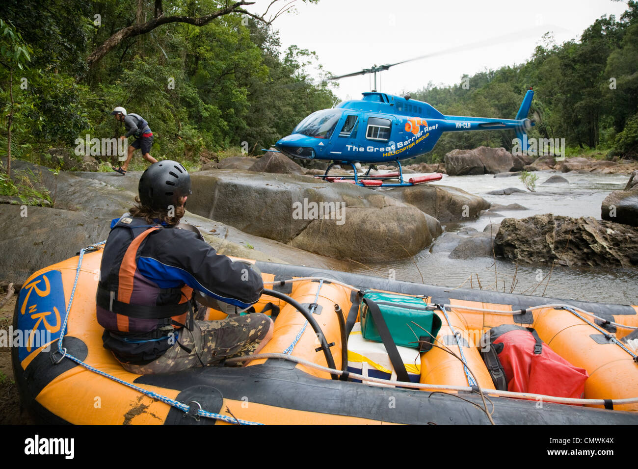 Helicopter dropping off people and equipment for a heli-rafting adventure on the North Johnstone River, Queensland, - Stock Image