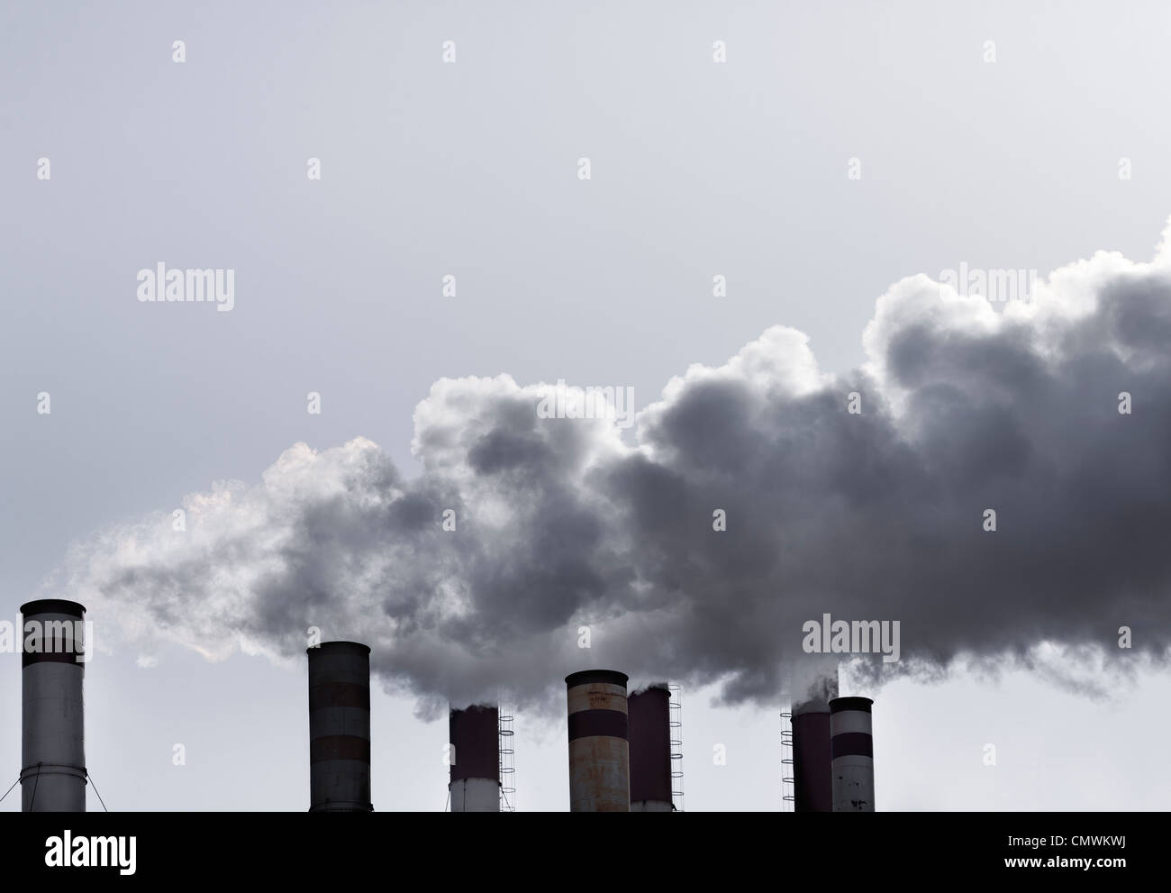 industrial tubes pollute the environment , ecology concept - Stock Image