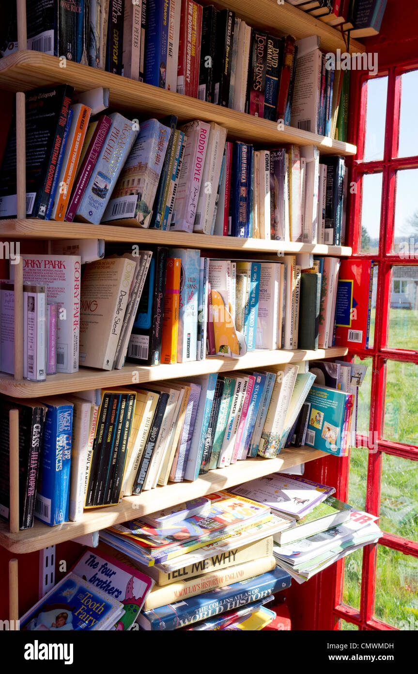 UK red telephone box converted to a book exchange - Stock Image