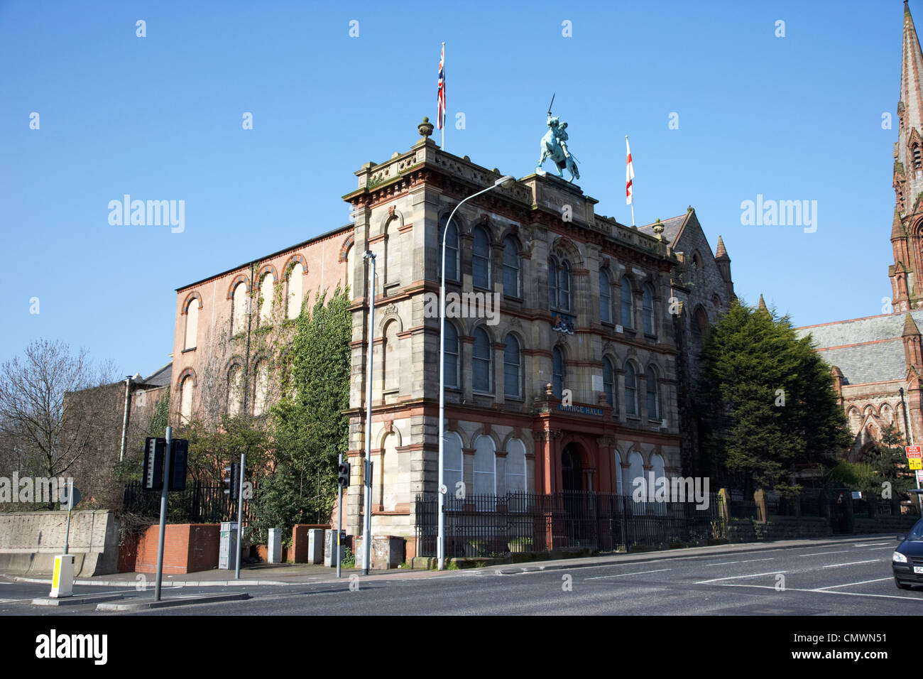 Clifton Street belfast Orange Hall with statue of king william on the top and stone facade Belfast Northern Ireland - Stock Image