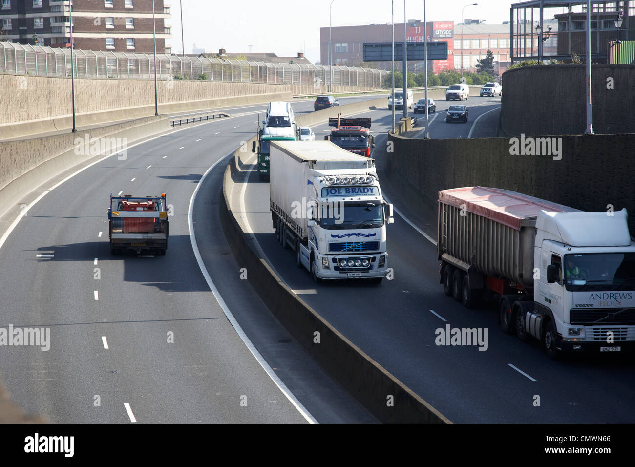 traffic including road haulage on the westlink a12 dual carriageway throughpass Belfast Northern Ireland uk - Stock Image