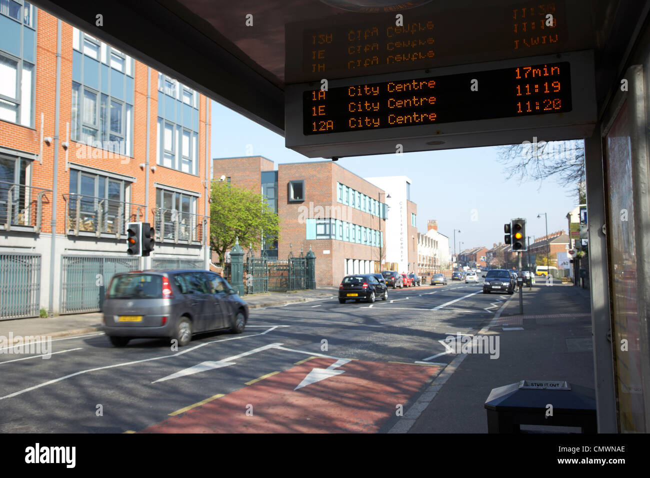 bus tracking system bustrak on a bus shelter stop on a main road in Belfast Northern Ireland uk - Stock Image