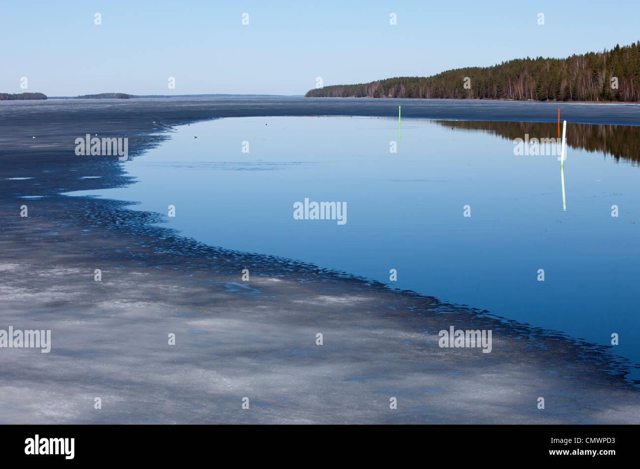 Melting ice on lake Iisvesi at Spring , Finland - Stock Image