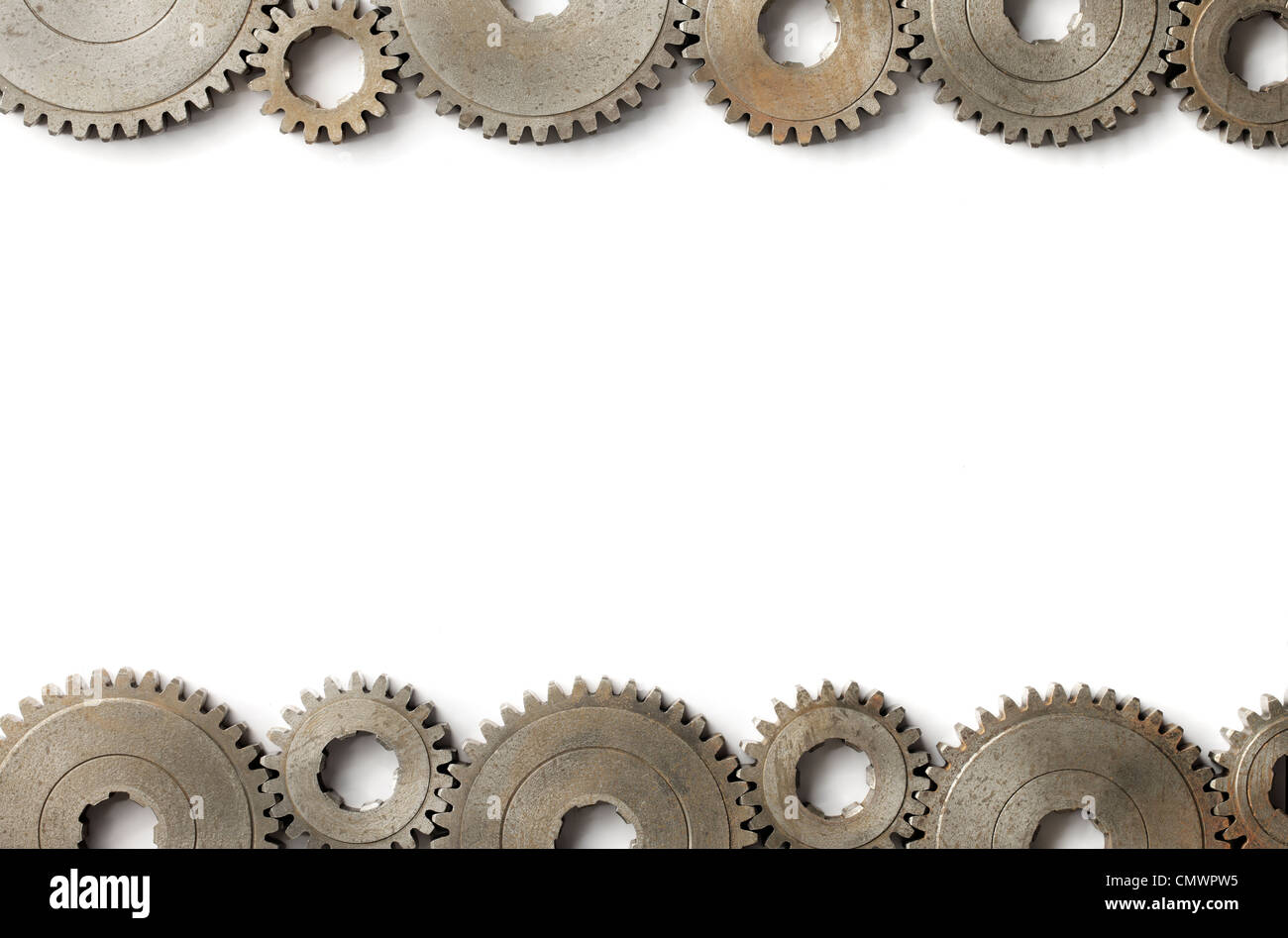 Background image with old cog gear wheels on the sides. - Stock Image