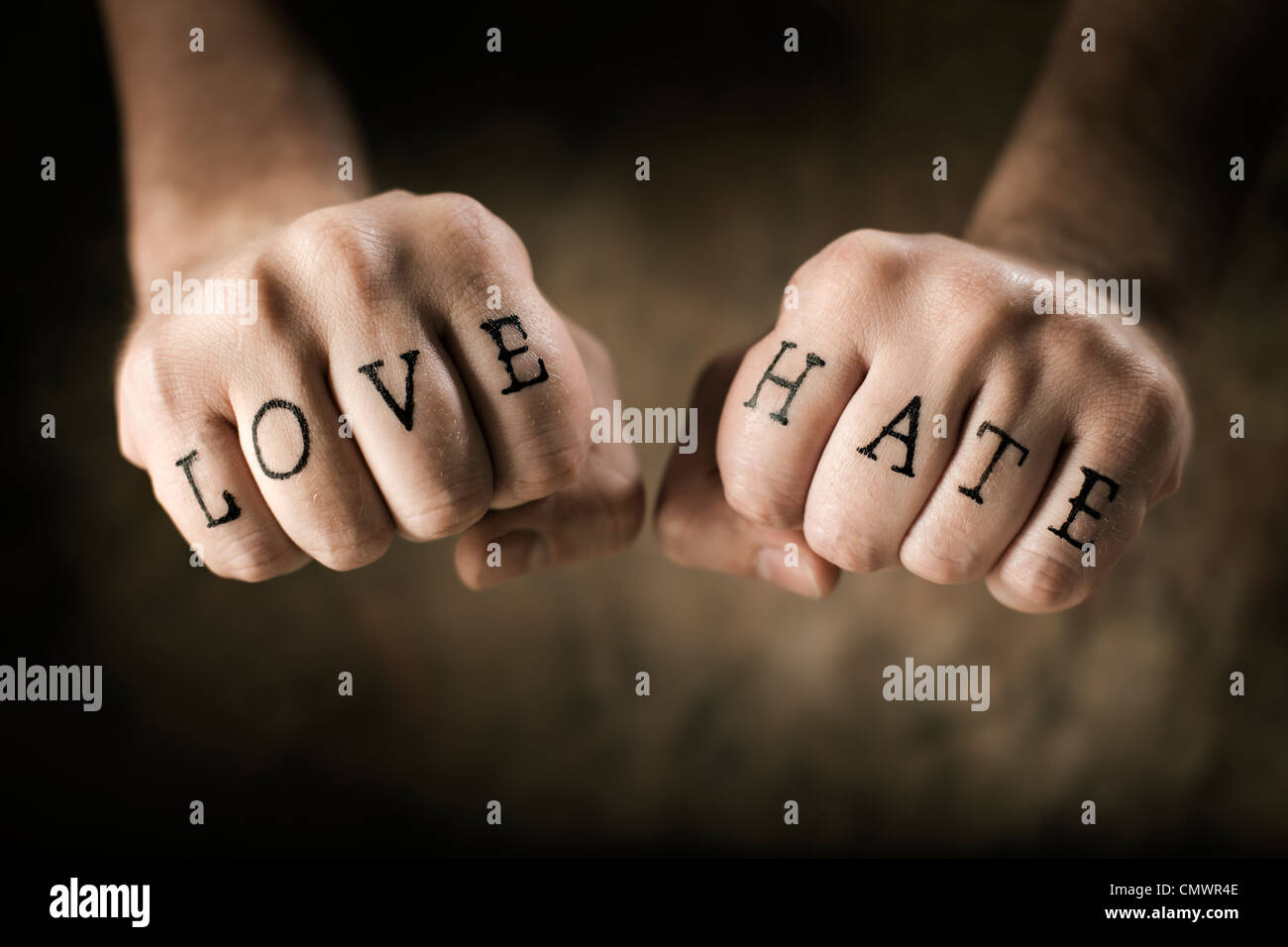 Man With Fake Love And Hate Tattoos On His Hands Stock