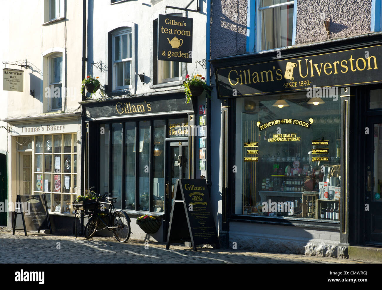 Small, independent shops on Market Street, in the town of Ulverston, Cumbria, England UK - Stock Image