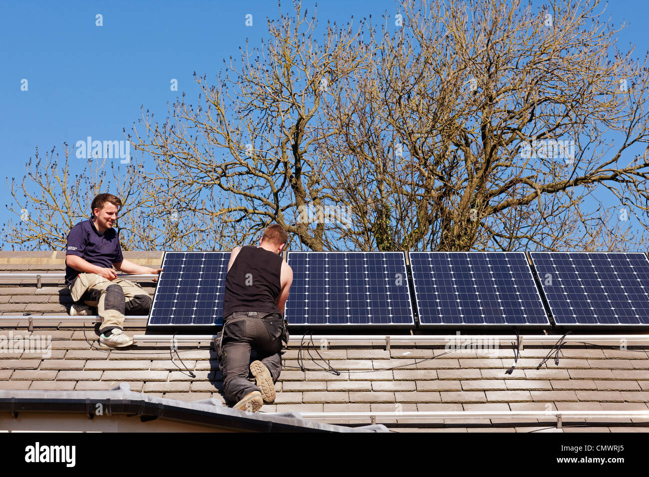 Solar panel installation on a roof - Stock Image