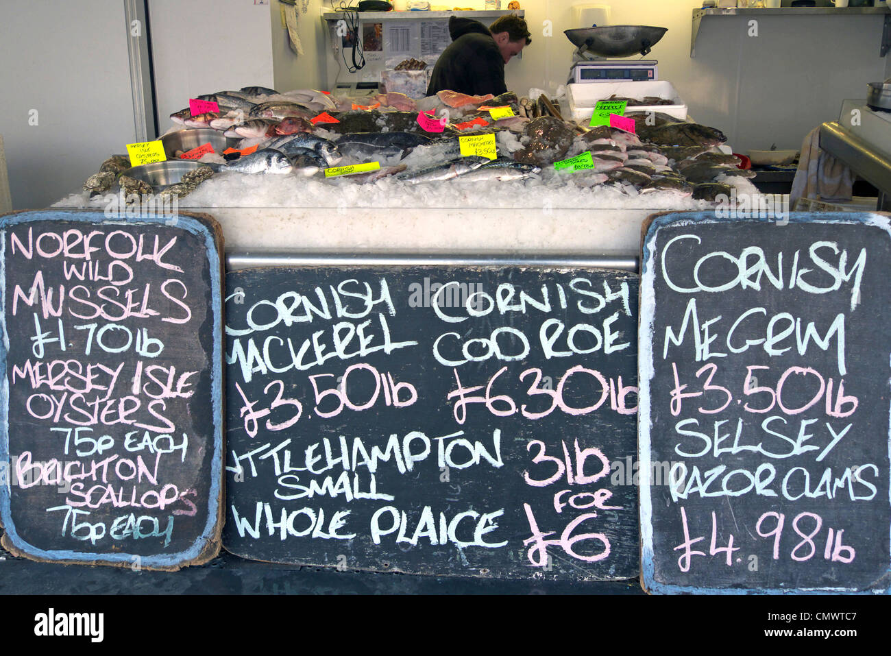 united kingdom littlehampton a wet fish display on a fishmongers stall - Stock Image