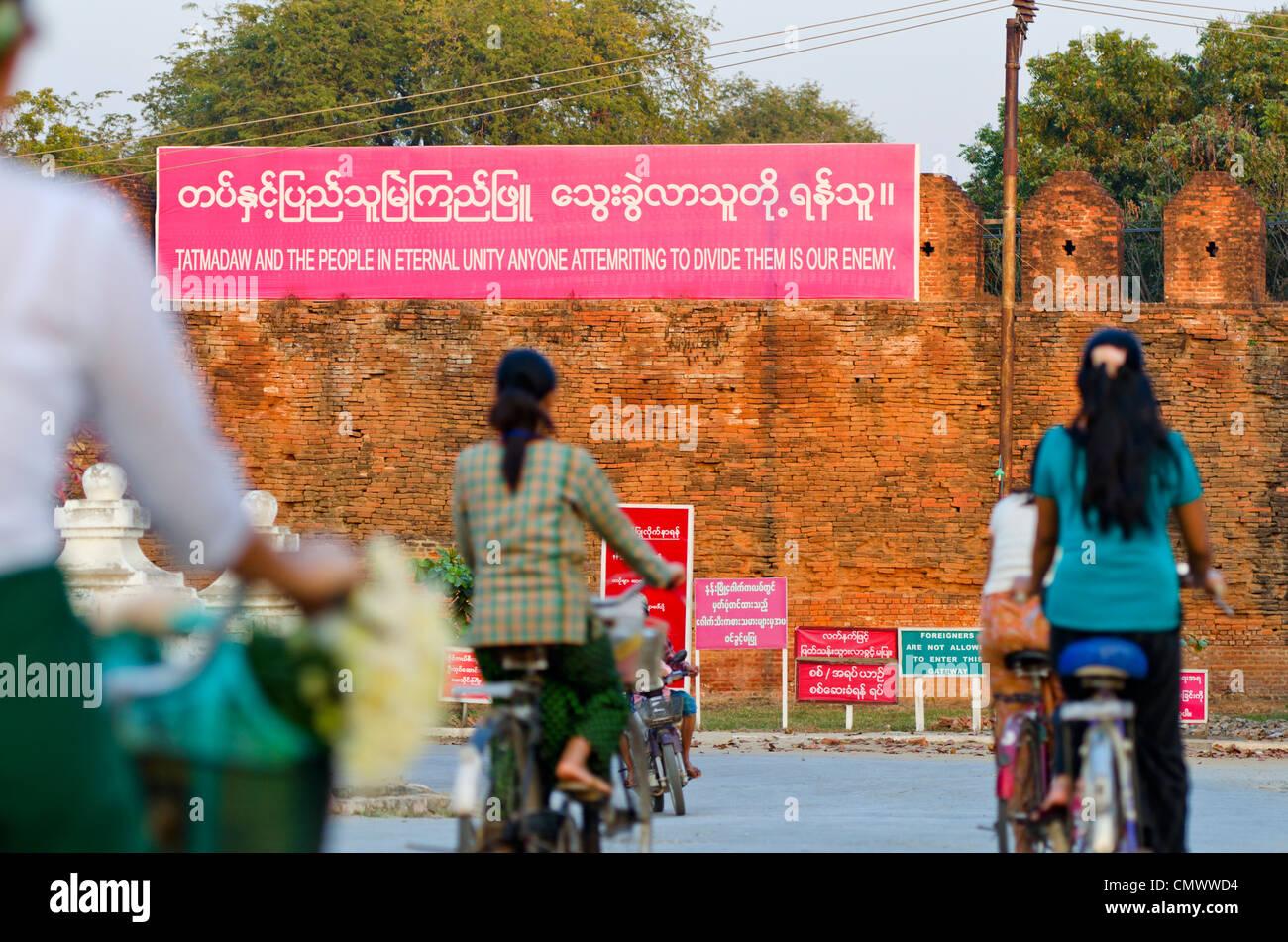 Propaganda poster on walls of Mandalay palace, Mandalay, Myanmar - Stock Image