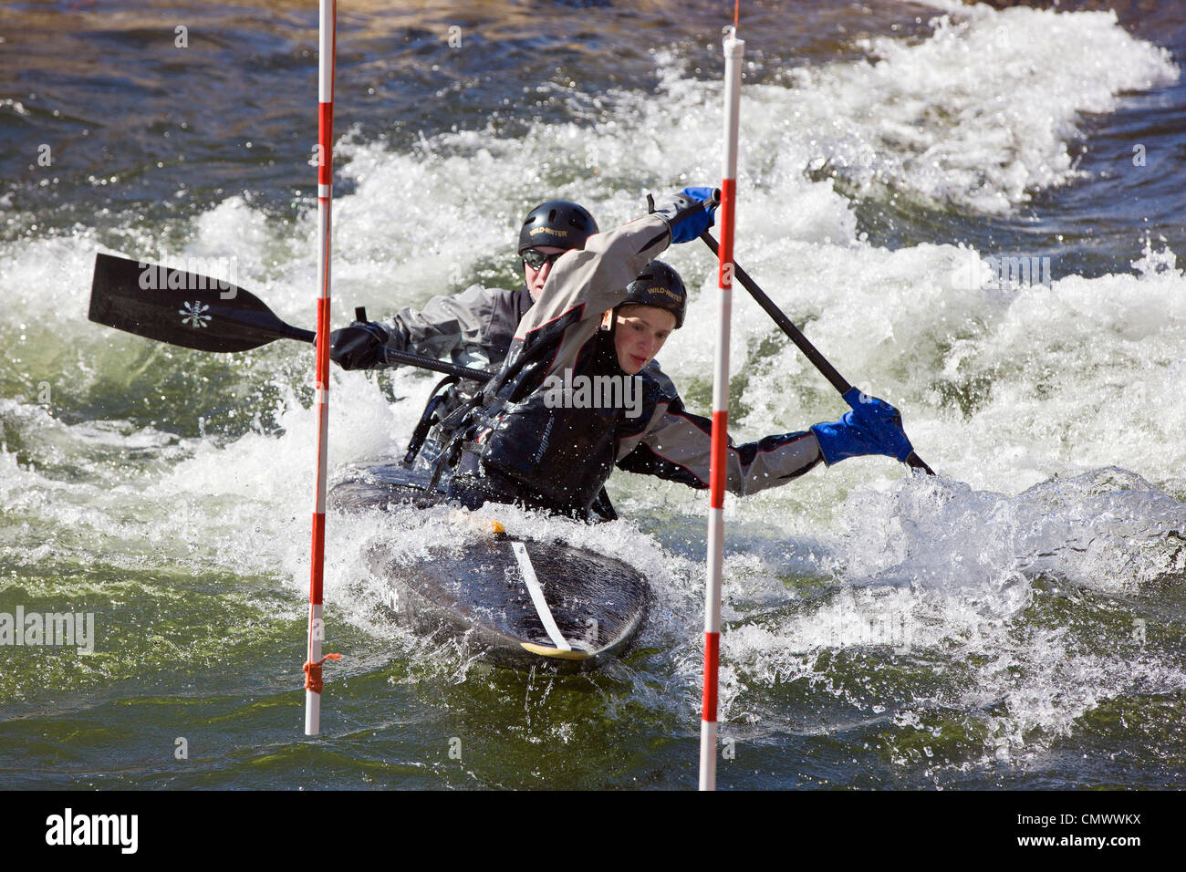 Tandem whitewater kayak slalom racers, Arkansas River, Salida, Colorado, USA - Stock Image