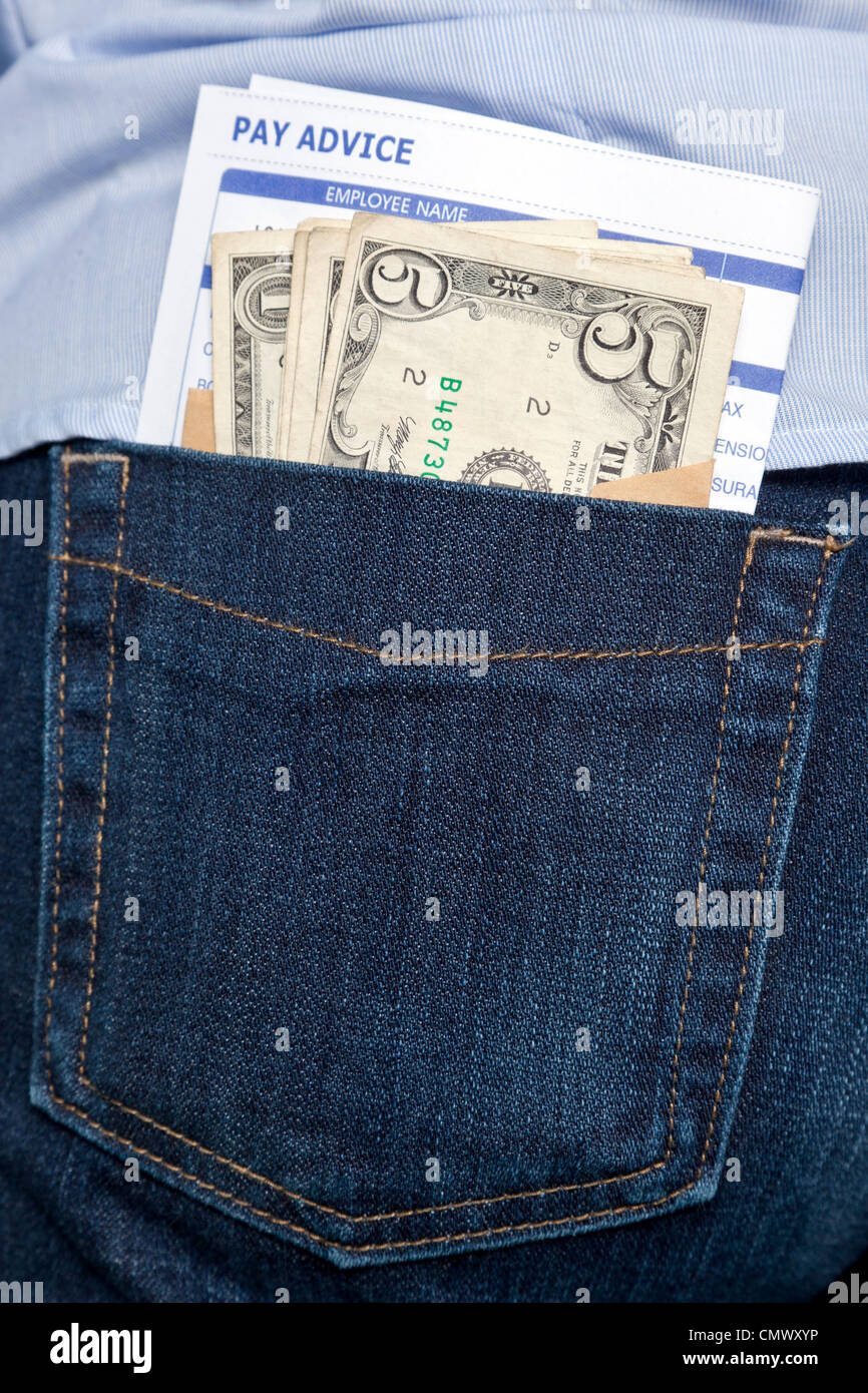 Photo of a payslip and cash sticking out of the back pocket in a pair of jeans. - Stock Image