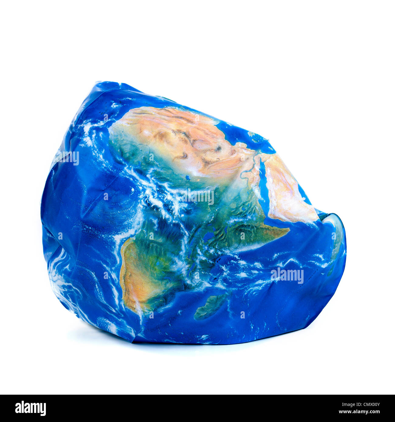 Plastic globe deflated - global / earth / broken / problems / climate change / environment concept - Stock Image