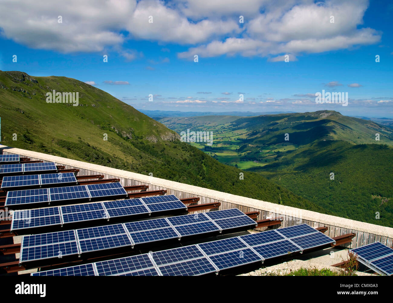 Solar farm with solar panels array in rural Cantal, Auvergne, France, Europe - Stock Image