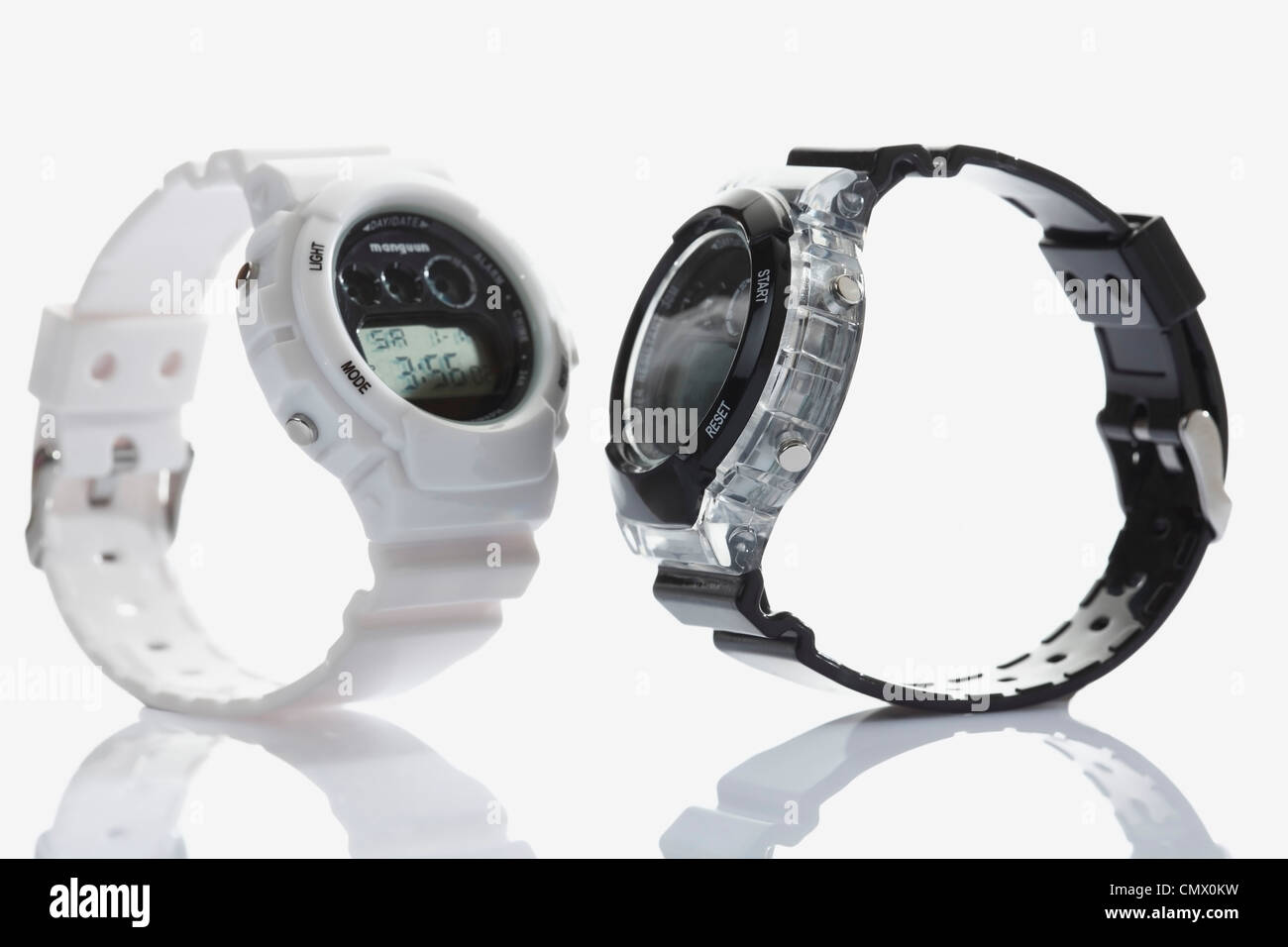 Sporting wrist watches on white background, close up - Stock Image