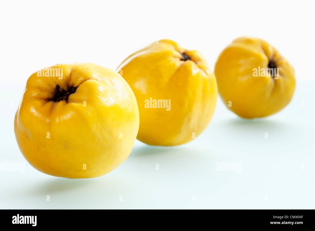 Quinces on white background, close up - Stock Image