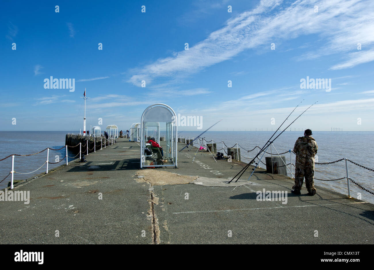 People anglers fishing from Clacton Pier in Essex. - Stock Image