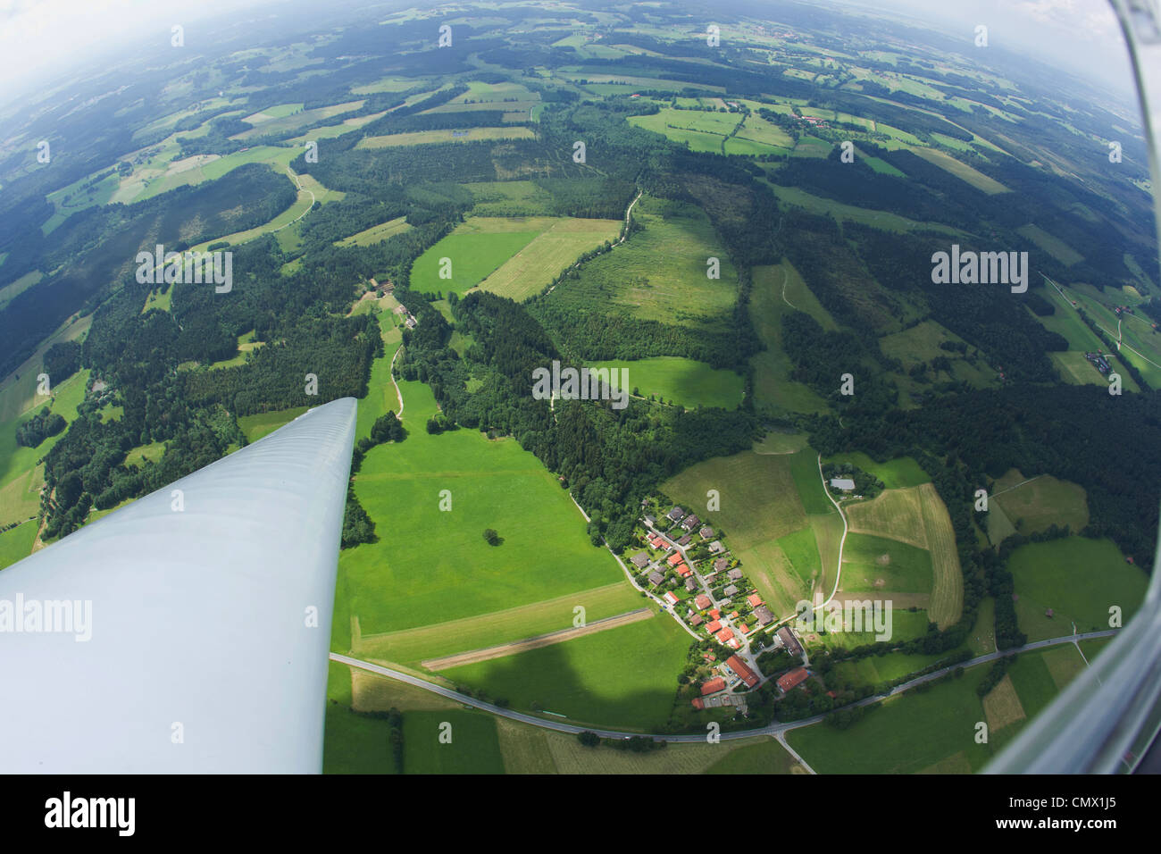 Germany, Bavaria, Bad Toelz, View of village and landscape from glider - Stock Image