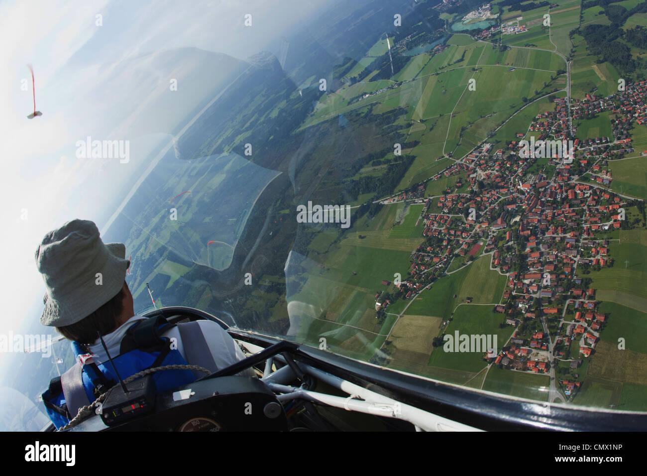 Germany, Bavaria, Bad Toelz, Mature man in glider - Stock Image