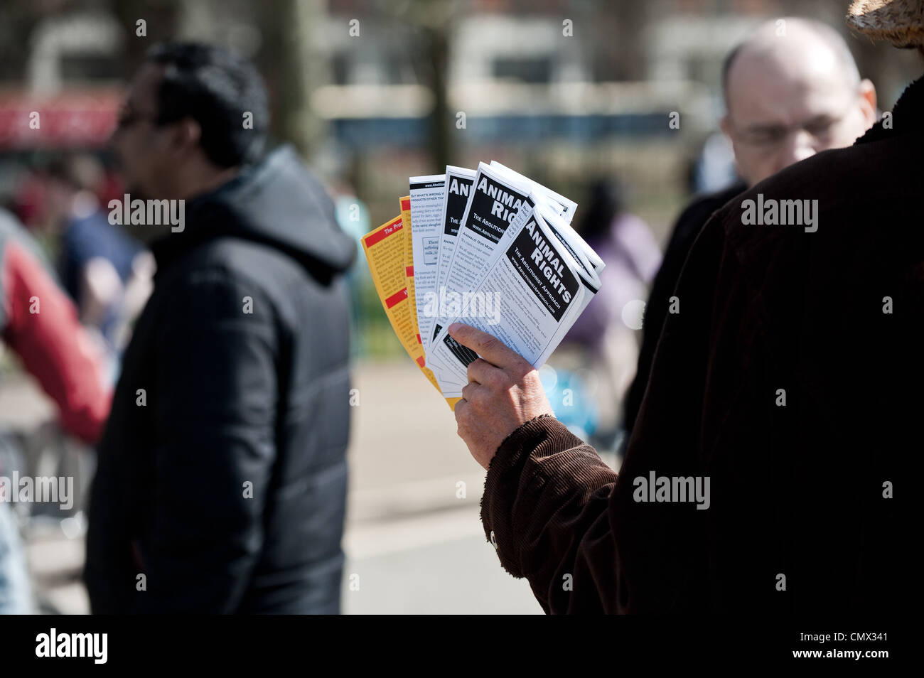 A man holding animal rights leaflets - Stock Image