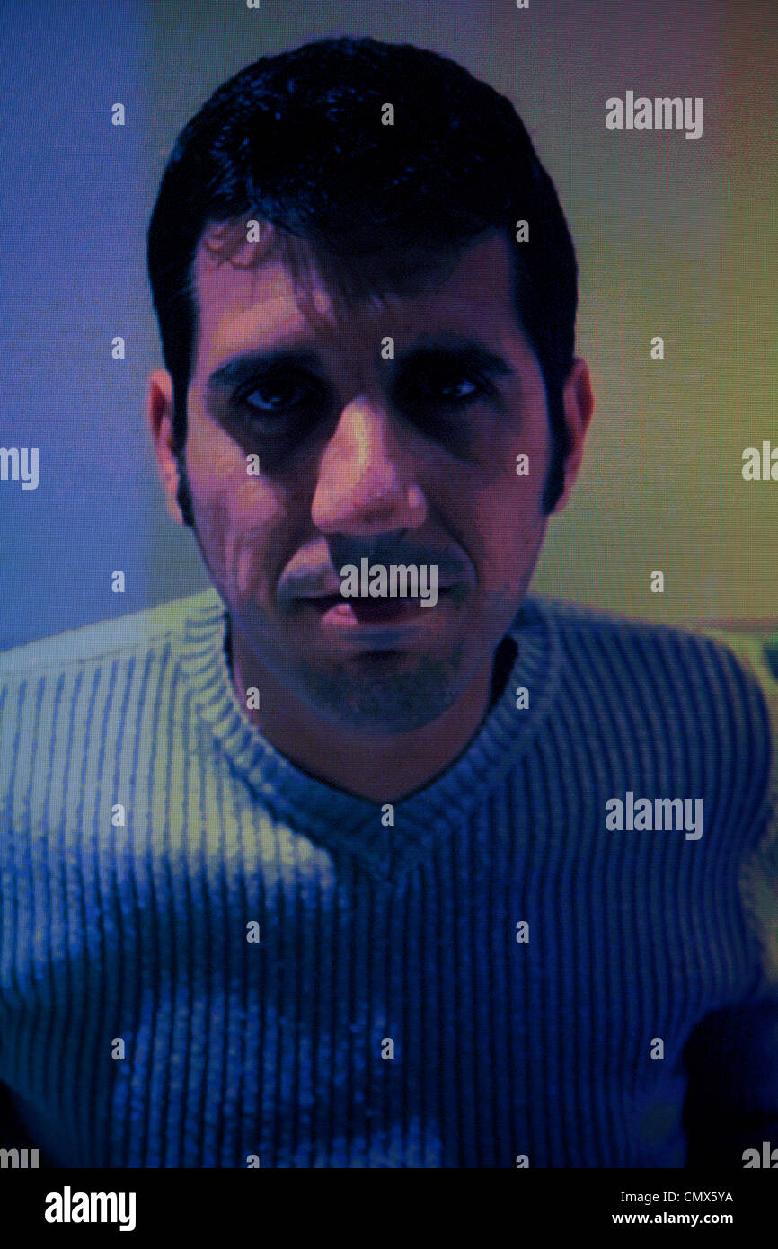 Man 's face on computer screen - Stock Image