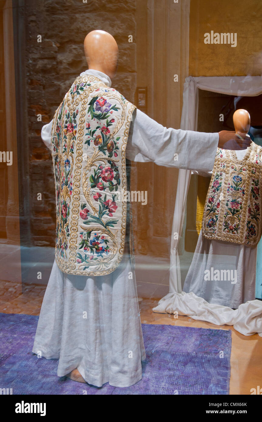 Italian Ecclesiastical gowns / robes in a makers shop window - Stock Image