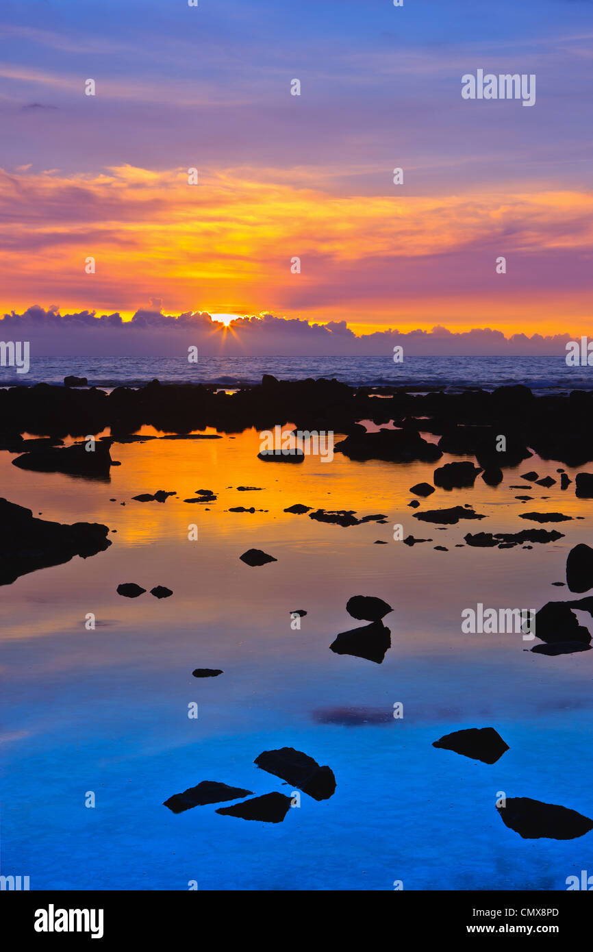 Sunset at the Pacific with lava in the foreground - The Big Island, Hawaii - Stock Image