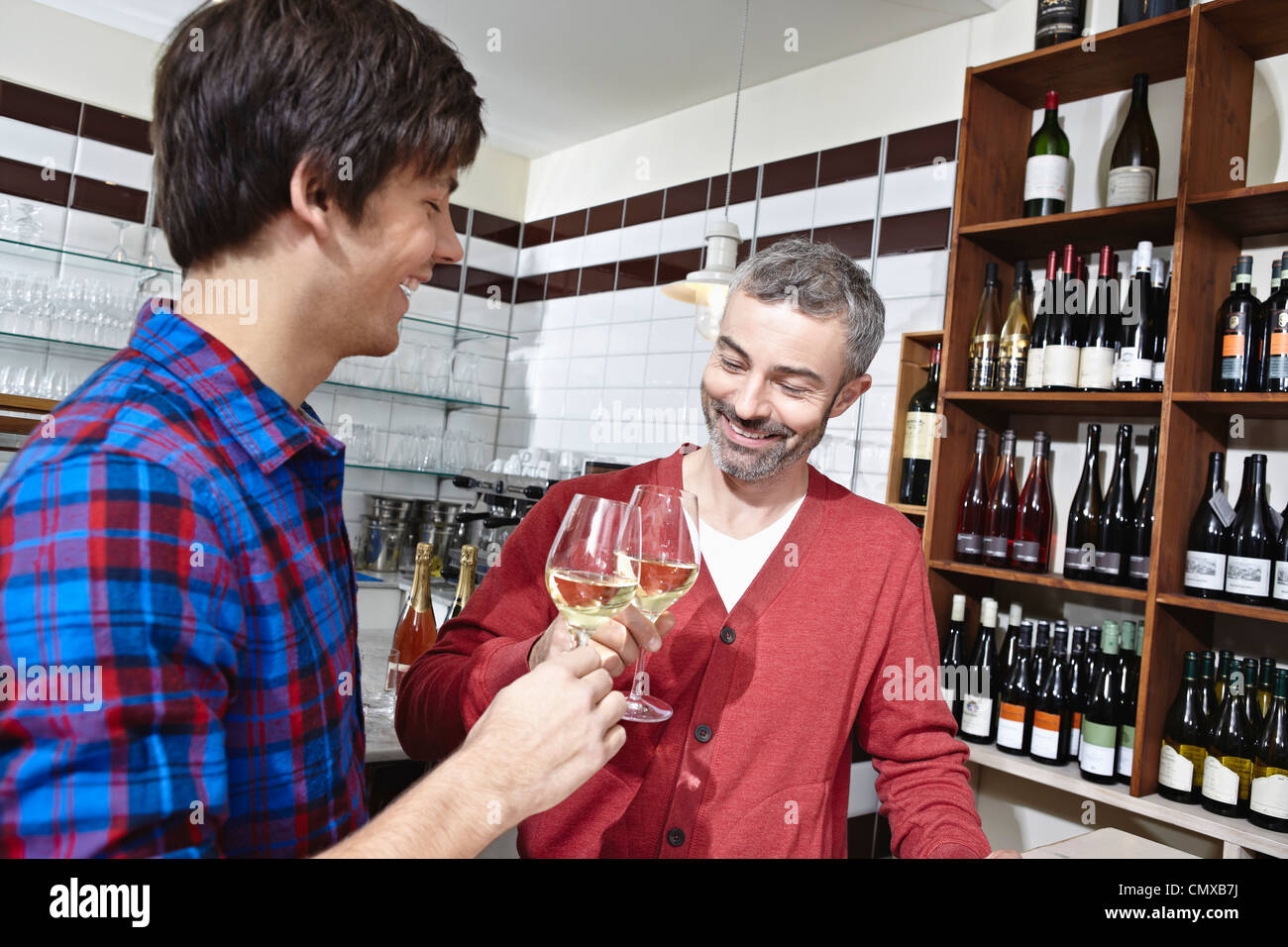 Germany, Cologne, Man having wine, smiling Stock Photo