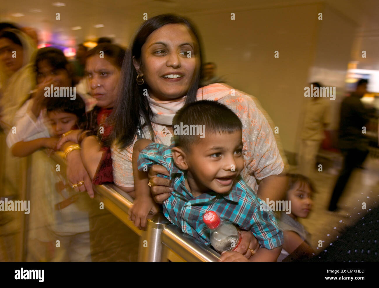 Family waiting at arrivals lounge at Heathrow airport - Stock Image