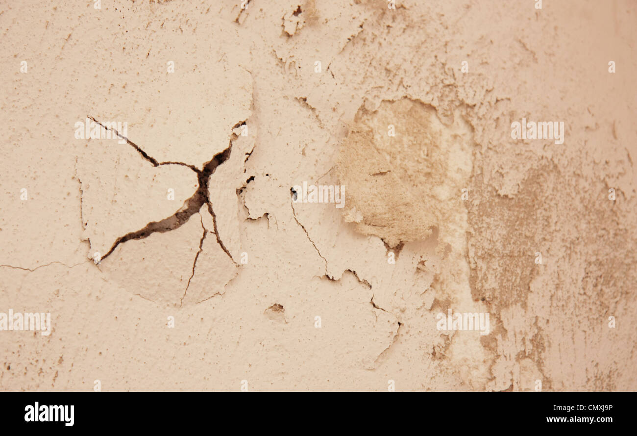 Damp and crack on a wall caused by humidity - Stock Image