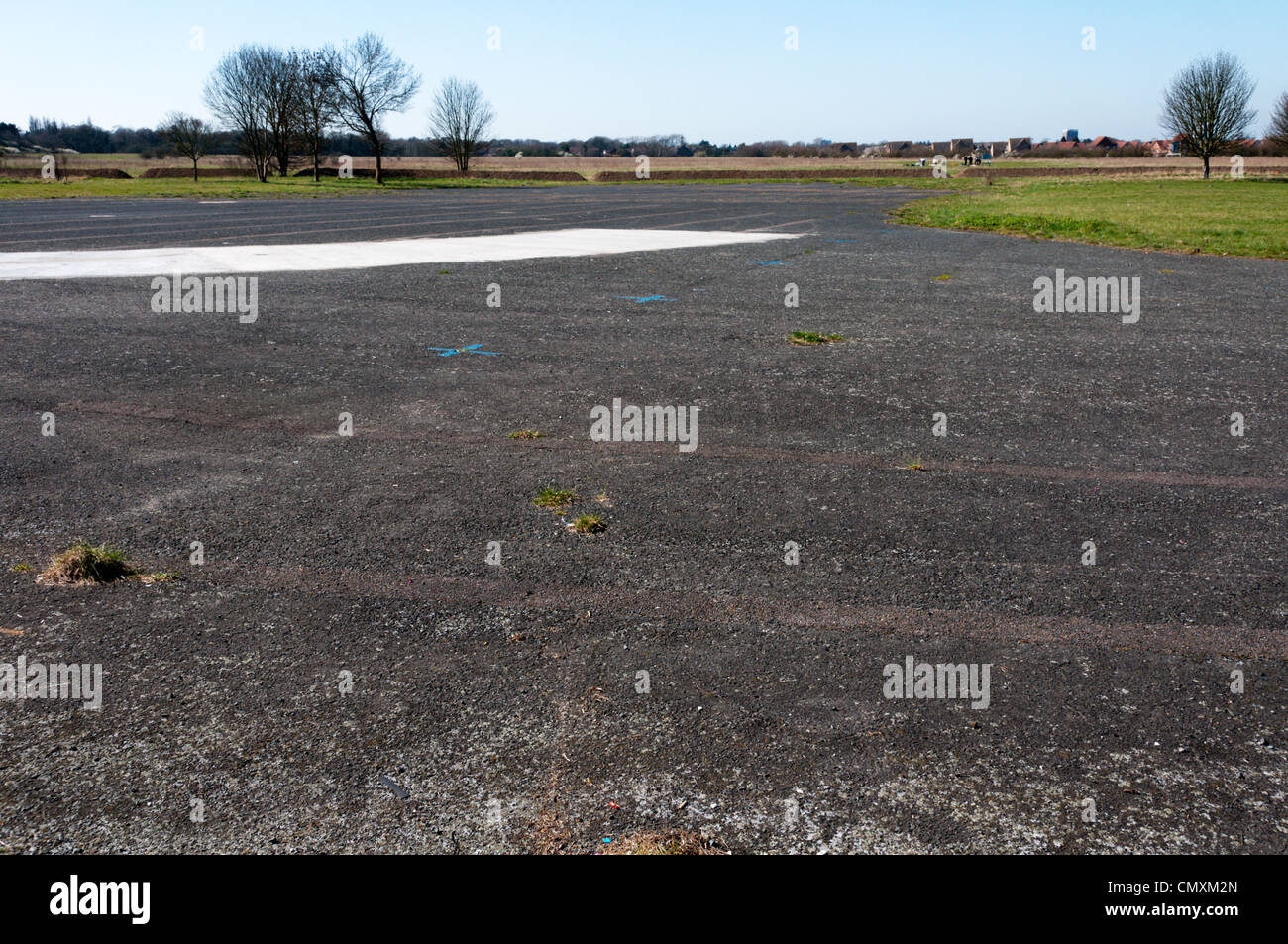 This area of tarmac is all that is left of the runways of the old Croydon Aerodrome in Roundshaw Park. SEE DESC - Stock Image