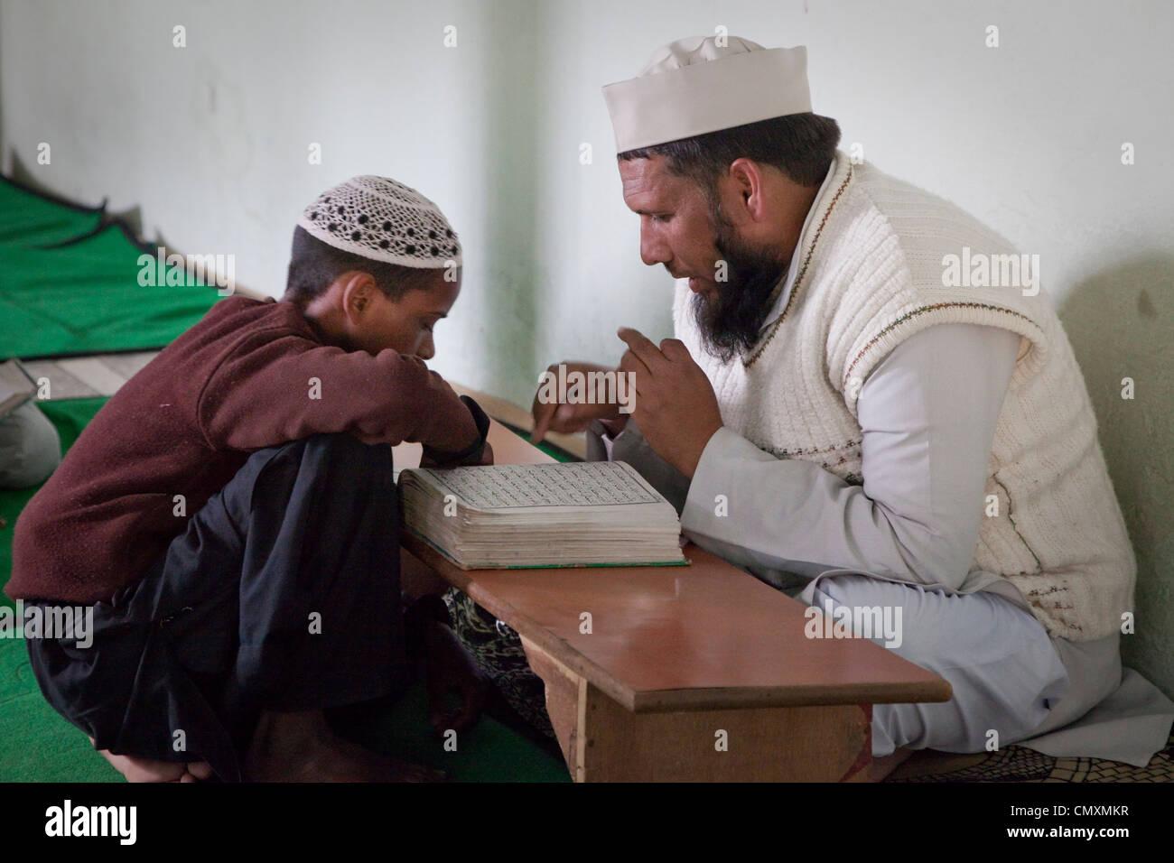 Imam Leads Madrasa Student through his Koranic Reading Lesson, Madrasa Imdadul Uloom, Dehradun, India. - Stock Image