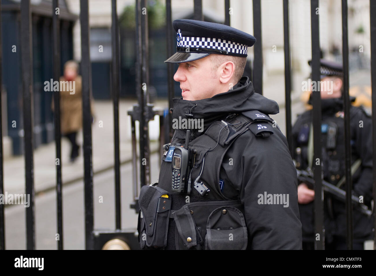 Armed police officers on patrol in Downing Street, London, England, UK Stock Photo