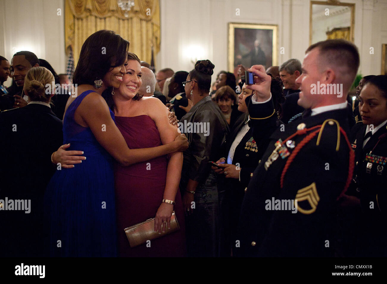 First Lady Michelle Obama is photographed with a guest during the Department of Defense dinner in the East Room - Stock Image