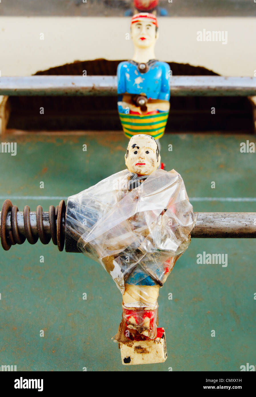 Broken and repaired table football players - Stock Image