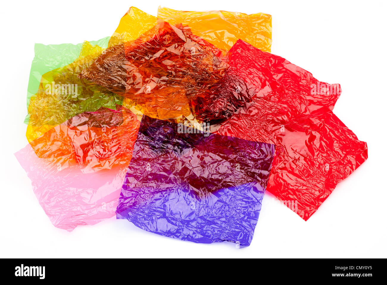 Pile of coloured sweet wrappers - Stock Image