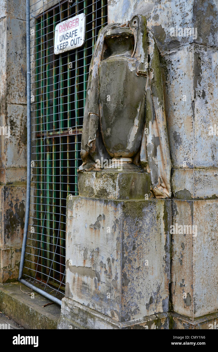 Detail from a neglected tomb at the Glasgow Necropolis, complete with  Health & Safety notice. - Stock Image