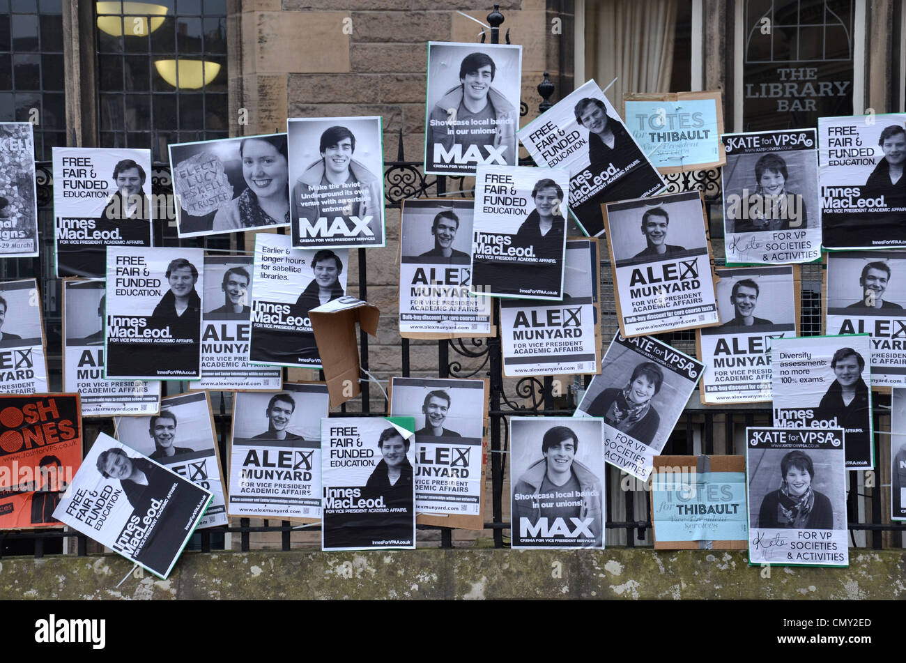 Posters for Edinburgh University Student Association (EUSA) elections on railings at the students union building - Stock Image