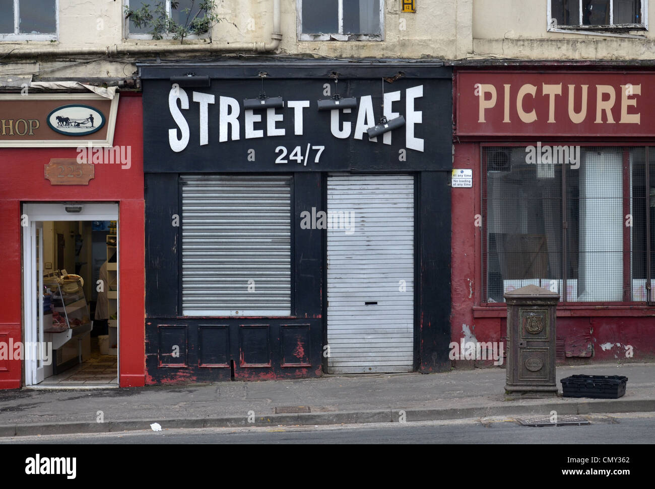 'Street Cafe' - a small cafe in Glasgow High Street which claims to be open 24/7 though that doesn't - Stock Image