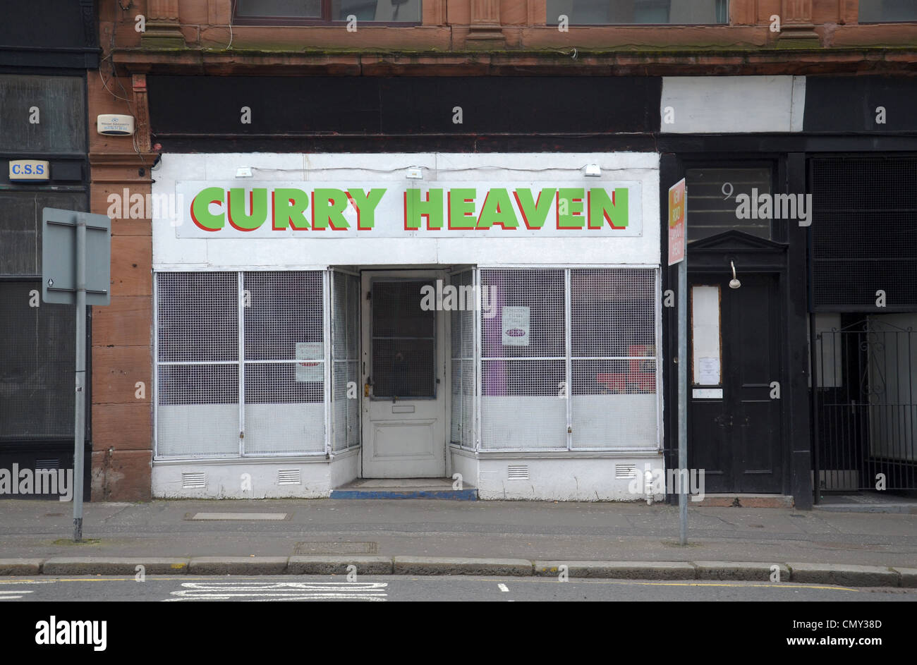 The facade of 'Curry Heaven' - a curry shop in Duke Street, Glasgow. - Stock Image