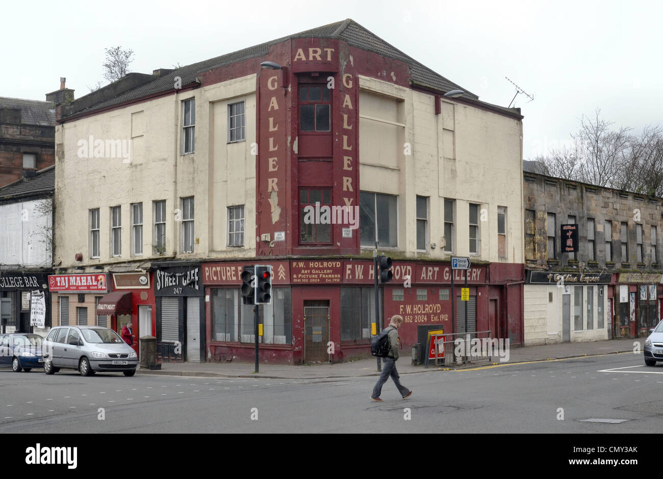 Some rather sad and rundown retail premises in Glasgow at the junction of High Street and George Street. - Stock Image